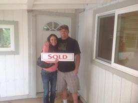 3/13/2015, the day we officially became home-owners! Photo credit (and realtor): Tom Horner